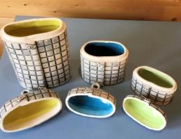 (V7) interior glaze on flower canisters