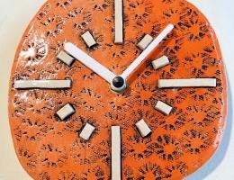 Deco orange ceramic clock approx 15 cm across