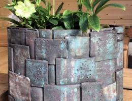 Dark stoneware elliptical planter with verdigris effect 33cm high x 45cm wide